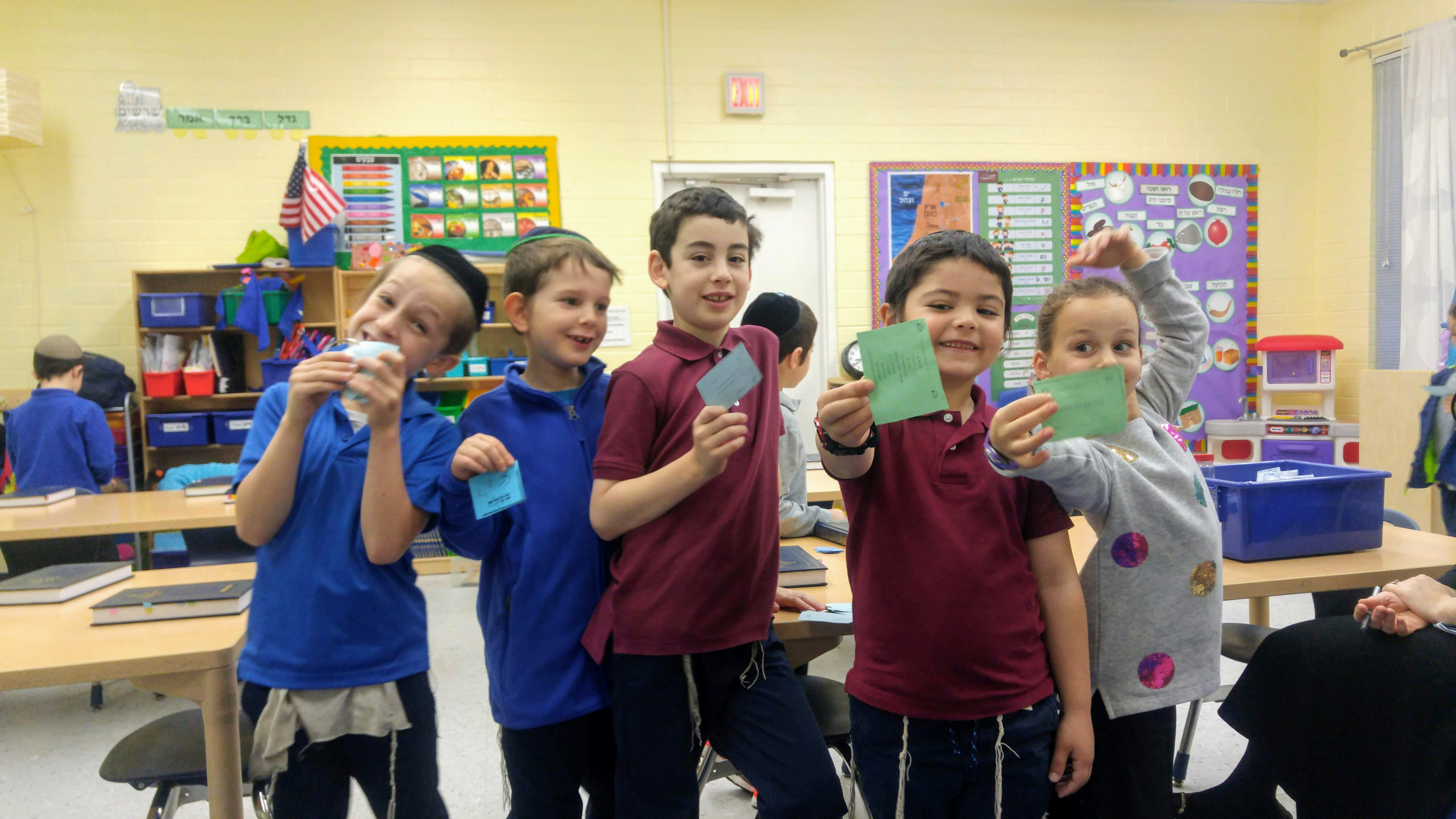 Kids with Yediot Klaliot cards.jpg